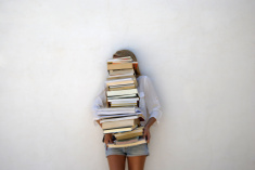 stock-photo-74074303-high-school-student-holding-lots-of-books